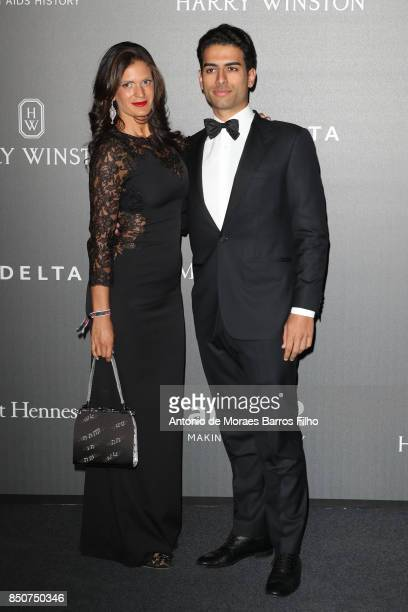 Veronica Berti and Amos Bocelli walk the red carpet of amfAR Gala Milano on September 21 2017 in Milan Italy
