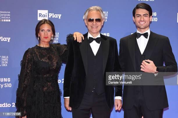 Veronica Berti, Andrea Bocelli and Matteo Bocelli walk a red carpet ahead of the 64. David Di Donatello awards ceremony - Red Carpet on March 27,...