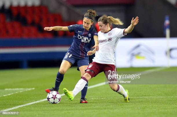 Veronica Boquete of Paris Saint Germain and Nicole Rolser of Bayern Munich compete for the ball during the Champions League match between Paris Saint...