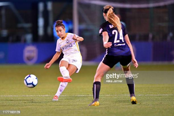 Veronica Boquete of Utah Royals FC passes the ball against Bethany Balcer of Seattle Reign FC during the match at Cheney Stadium on September 25 2019...