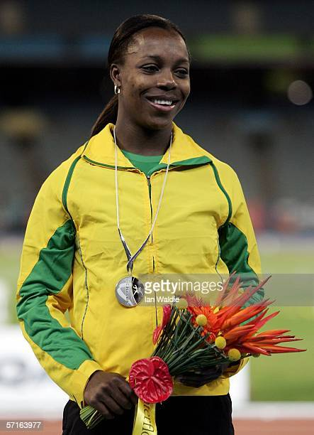 Veronica Campbell of Jamaica poses with her silver medal during the medal ceremony for women's 200 metre final at the athletics during day eight of...