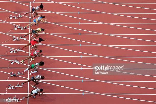 Veronica Campbell-Brown of Jamaica and Carmelita Jeter of the United States start in the Women's 100m Semi Final on Day 8 of the London 2012 Olympic...