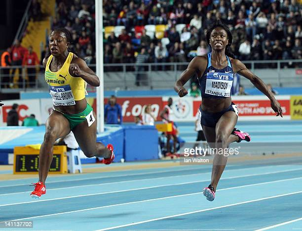 Veronica CampbellBrown of Jamaica and Tianna Madison of the United States compete in the Women's 60 Metres Final during day three of the 14th IAAF...