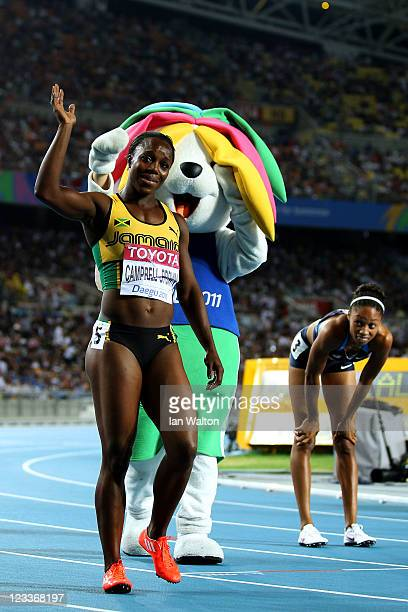 Veronica Campbell-Brown of Jamaica celebrates winning the women's 200 metres final with mascot Sarbi during day seven of 13th IAAF World Athletics...