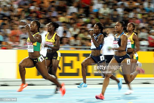 Veronica Campbell-Brown of Jamaica wins the women's 200 metres final ahead of Carmelita Jeter of the USA during day seven of 13th IAAF World...