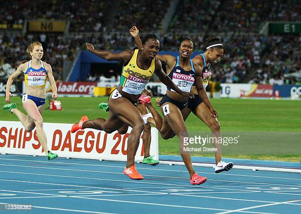 Veronica Campbell-Brown of Jamaica wins the women's 200 metres final ahead of Carmelita Jeter and Allyson Felix of the USA during day seven of 13th...