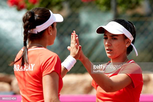 Veronica Cepede of Paraguay celebrates a point with her teammate Montserrat Gonzalez in their doubles match against Georgina Garca Perez and Maria...