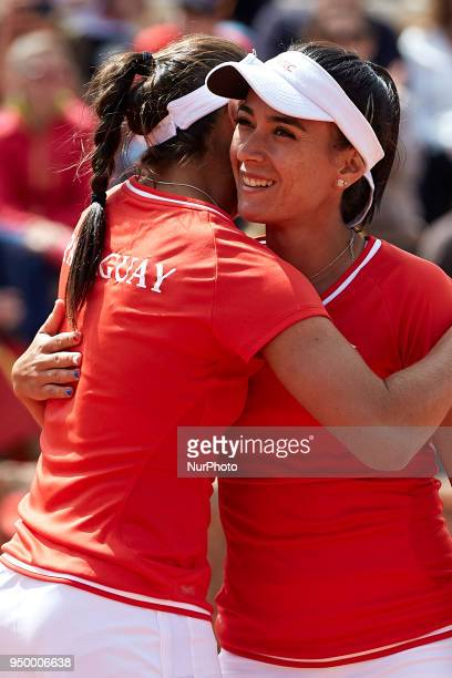 Veronica Cepede of Paraguay celebrates the victory with her teammate Montserrat Gonzalez in their doubles match against Georgina Garca Perez and...