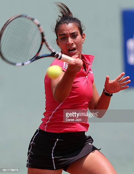 Veronica Cepede of Paraguay returns the ball to Bianca Botto of Peru during the women's teams final tennis match as part of the XVII Bolivarian Games...