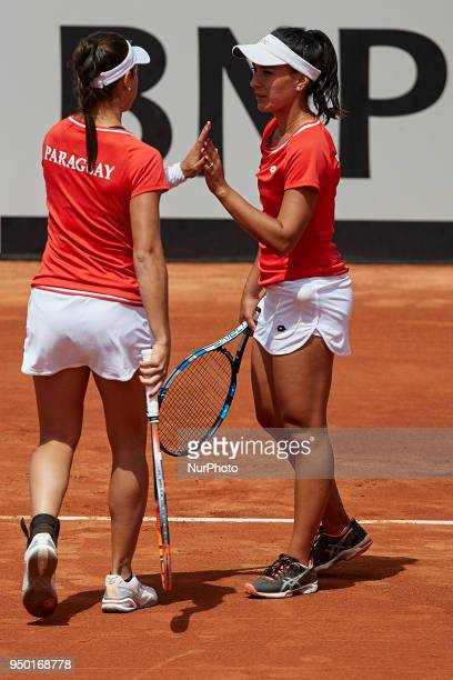 Veronica Cepede Royg and Montserrat Gonzalez of Paraguay celebrate a point in their doubles match against Georgina Garca Perez and Maria Jose Martnez...