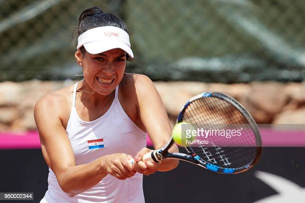 Veronica Cepede Royg of Paraguay in action in her match against Garbine Muguruza of Spain during day two of the Fedcup World Group II Playoffs match...