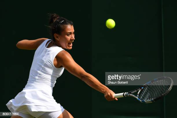 Veronica Cepede Royg of Paraguay plays a backhand during the Ladies Singles first round match against Barbora Strycova of the Czech Republic on day...