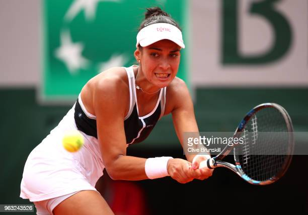 Veronica Cepede Royg of Paraguay plays a backhand during the ladies singles first round match aganist Petra Kvitova of Czech Republic during day two...
