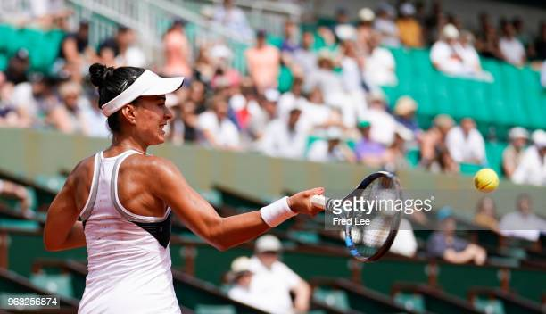 Veronica Cepede Royg of Paraguay plays a forehand during the ladies singles first round match aganist Petra Kvitova of Czech Republic during day two...