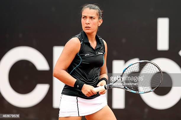 Veronica Cepede Royg of Paraguay returns a shot to Paula Cristina Goncalves of Brazil during the Rio Open at the Jockey Club Brasileiro on February...