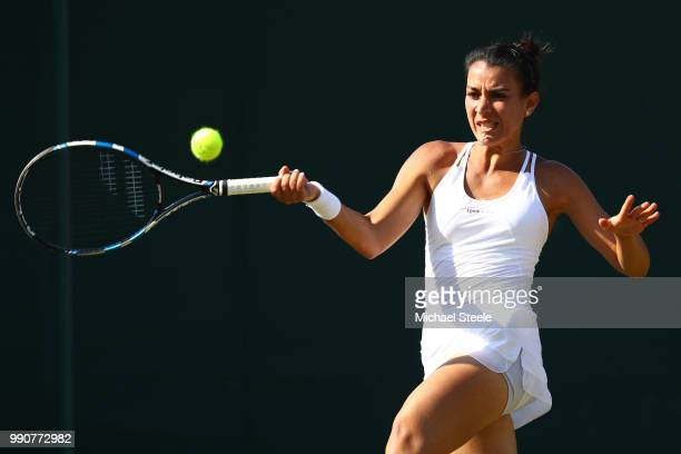 Veronica Cepede Royg of Paraguay returns against Katie Boulter of Great Britain during their Ladies' Singles first round match on day two of the...