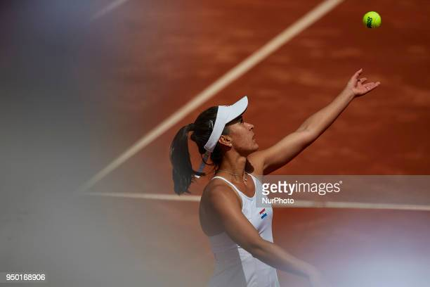Veronica Cepede Royg of Paraguay serves in her match against Garbine Muguruza of Spain during day two of the Fedcup World Group II Playoffs match...