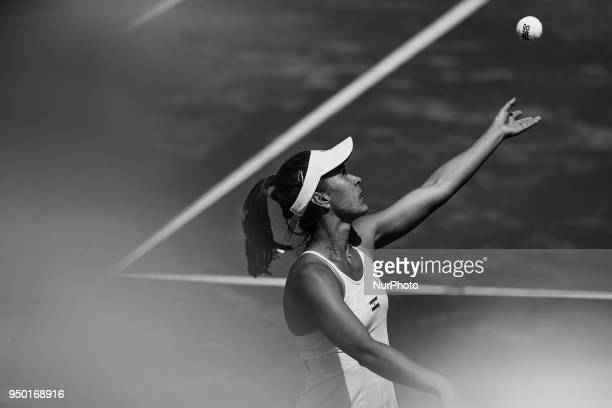 the image has been converted to black and white Veronica Cepede Royg of Paraguay serves in her match against Garbine Muguruza of Spain during day two...