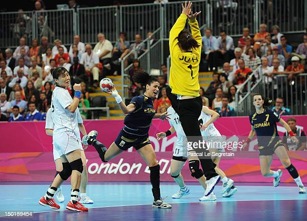 Veronica Cuadrado Dehesa of Spain prepares to shoot against South Korea's coach Kang Jae Won during the Women's Handball Bronze medal match between...