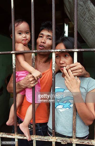 Veronica Delacruz with her husband Jaime and Jasmine inside their cell barrack at Manila City Jail. Jaime is a member of Batang City Jail, one of 4...