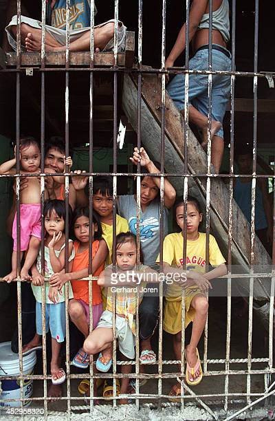 Veronica Delacruz with her husband Jaime and kids inside their cell barrack at Manila City Jail. Jaime is a member of Batang City Jail, one of 4...