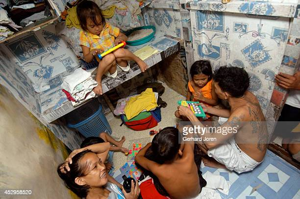 Veronica Delacruz with her husband Jaime and kids inside their cell at Manila City Jail. Jaime is a member of Batang City Jail, one of 4 major gangs...