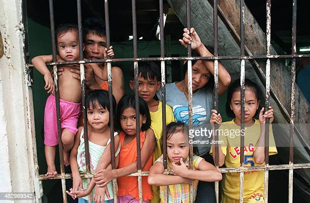 Veronica Delacruz with her husband Jaime and kids inside their cell barrack at Manila City Jail Jaime is a member of Batang City Jail one of 4 major...
