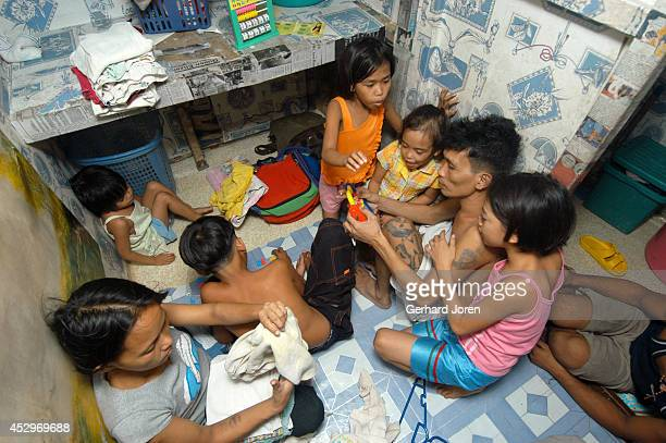Veronica Delacruz with her husband Jaime and kids inside their cell at Manila City Jail Jaime is a member of Batang City Jail one of 4 major gangs in...