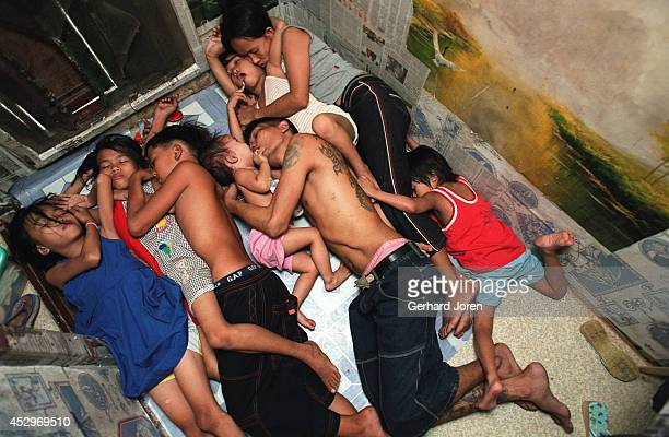 Veronica Delacruz with her husband Jaime and their kids have an afternoon nap inside their cell at Manila City Jail Jaime is a member of Batang City...