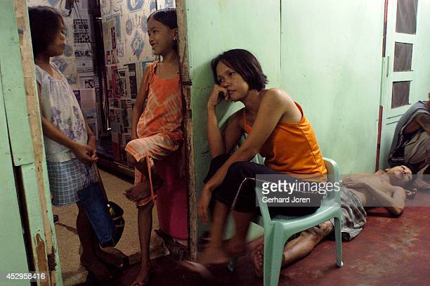 Veronica Delacruz with her husband Jaime and their kids inside their cell barrack at Manila City Jail. Jaime is a member of Batang City Jail, one of...