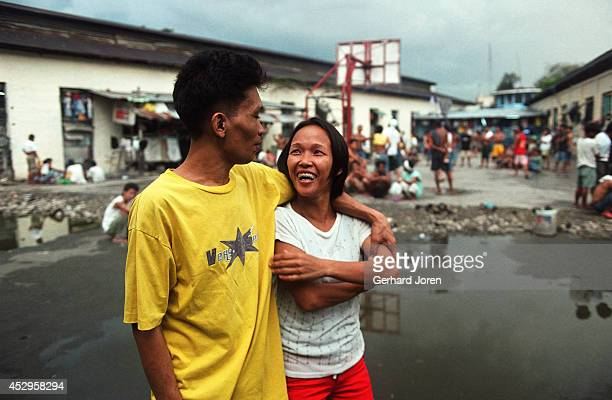 Veronica Delacruz with her husband Jaime outside their cell barrack at Manila City Jail. Jaime is a member of Batang City Jail, one of 4 major gangs...