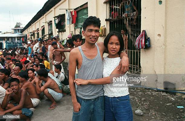 Veronica Delacruz with her husband Jaime outside their cell barrack at Manila City Jail Jaime is a member of Batang City Jail one of 4 major gangs in...