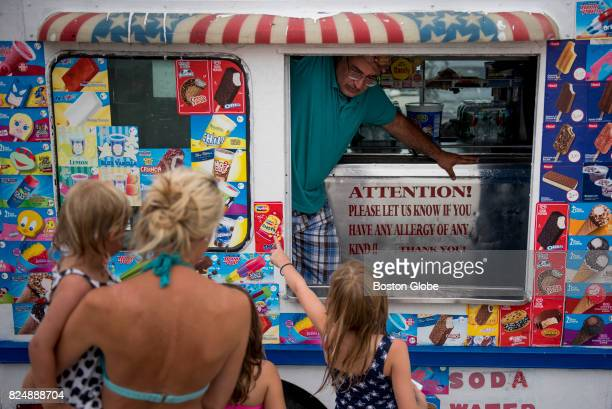 Veronica Ellis points to the ice cream she wants at Wessagusset Beach in Weymouth Mass July 22 2017