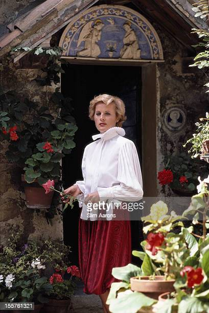 Veronica Fattori poses holding a flower in the garden of her family's summer home in San Marino in September 1982