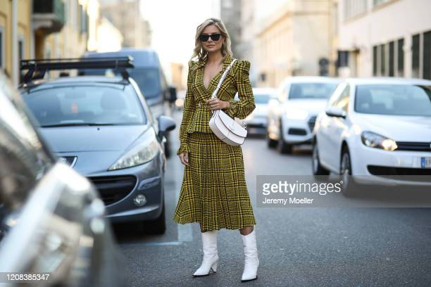 Veronica Ferraro is seen wearing a yellow skirt and jacket before Tods during Milan Fashion Week Fall/Winter 20202021 on February 21 2020 in Milan...