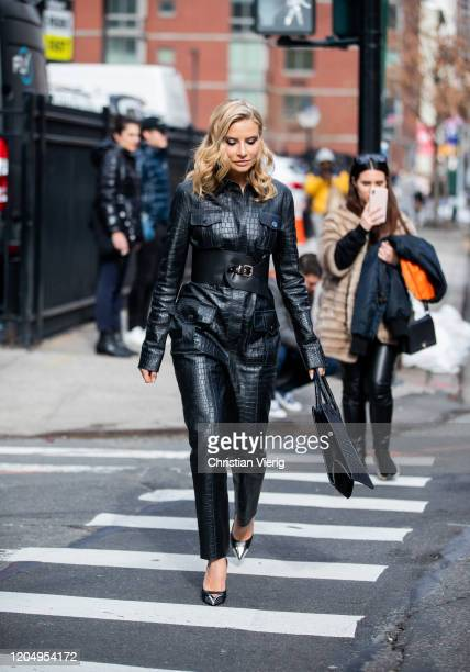 Veronica Ferraro is seen wearing black overall outside Longchamp during New York Fashion Week Fall/Winter 20 on February 08 2020 in New York City