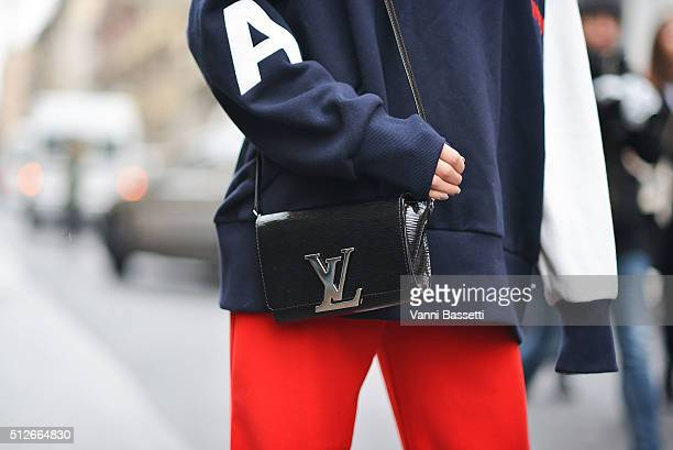 Veronica Ferraro poses wearing an Ader Error sweatshirt and Louis Vuitton bag before the Antonio Marras show during the Milan Fashion Week...