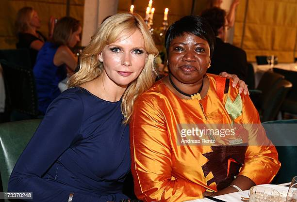 Veronica Ferres and Fatou Bensouda attends the Cinema for Peace UN women charity dinner at Soho House on July 12 2013 in Berlin Germany
