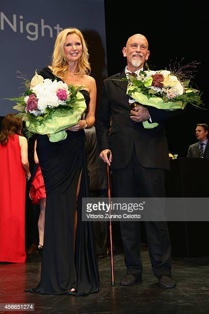 Veronica Ferres and John Malkovich seen on stage at the Award Night Ceremony during Day 10 of Zurich Film Festival 2014 on October 4 2014 in Zurich...