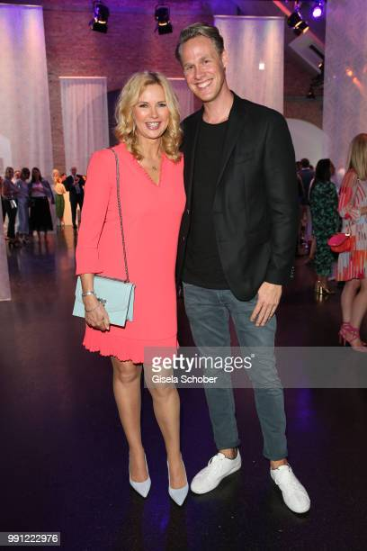 Veronica Ferres and Urs Konstantin Rouette during the Marc Cain Fashion Show Spring/Summer 2019 at WEEC Westhafen on July 3 2018 in Berlin Germany