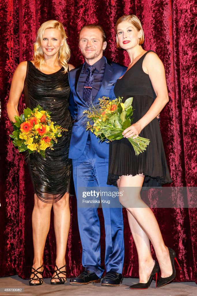 Veronica Ferres, Simon Pegg and Rosamund Pike attend the premiere of the film 'Hector and the Search for Happiness' (German title: 'Hectors Reise') at Zoo Palast on August 05, 2014 in Berlin, Germany.