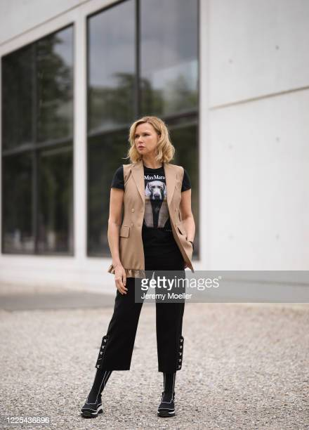 Veronica Ferres wearing Max Mara shirt and vest, Longchamp sneaker on May 13, 2020 in Munich, Germany.