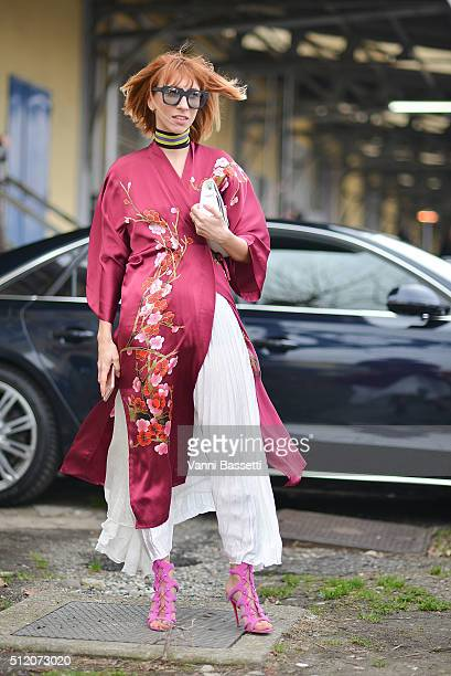 Veronica Giomini poses wearing a Whezy Shelly kimono Messagerie skirt and Louboutin shoes before the Gucci show during the Milan Fashion Week...