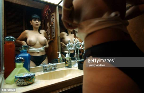 Veronica Gonzalez Garcia President of Women for a Healthy World gets dressed for the evening at her home in Guadalajara Mexico Nov 8 2002 Garcia was...