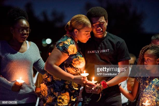 TOPSHOT Veronica Hartfield widow of Las Vegas Metropolitan Police Department Officer Charleston Hartfield their son Ayzayah Hartfield their daughter...