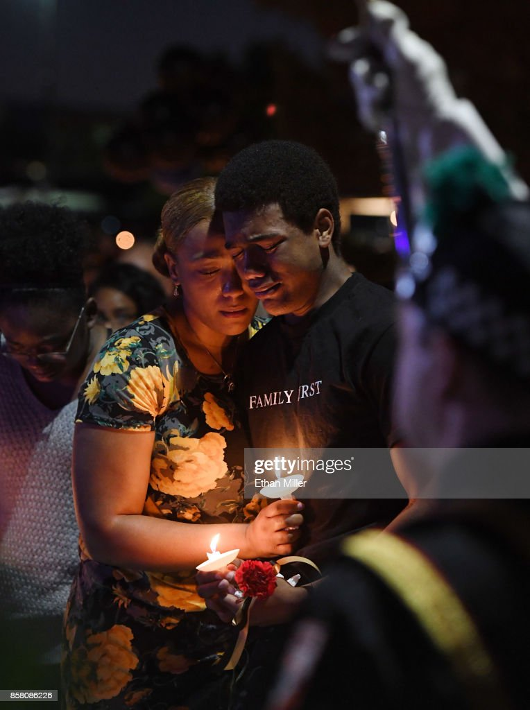 Veronica Hartfield (L), widow of slain Las Vegas Metropolitan Police Department Officer Charleston Hartfield, and their son Ayzayah Hartfield, 15, attend a vigil for Charleston Hartfield at Police Memorial Park on October 5, 2017 in Las Vegas, Nevada. Charleston Hartfield, who was off duty at the Route 91 Harvest country music festival on October 1, was killed when Stephen Paddock opened fire on the crowd killing at least 58 people and injuring more than 450. The massacre is one of the deadliest mass shooting events in U.S. history.