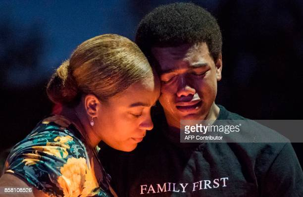 TOPSHOT Veronica Hartfield widow of slain Las Vegas Metropolitan Police Department Officer Charleston Hartfield and their son Ayzayah Hartfield...
