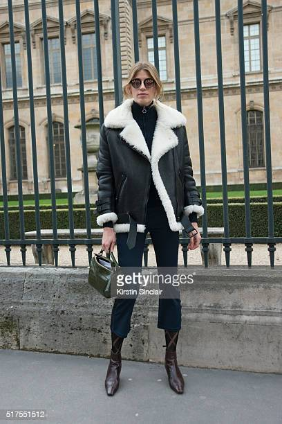 Veronica Heilbrunner wears a Acne jacket Loewe bag and Dior sunglasses on day 4 during Paris Fashion Week Autumn/Winter 2016/17 on March 4 2016 in...