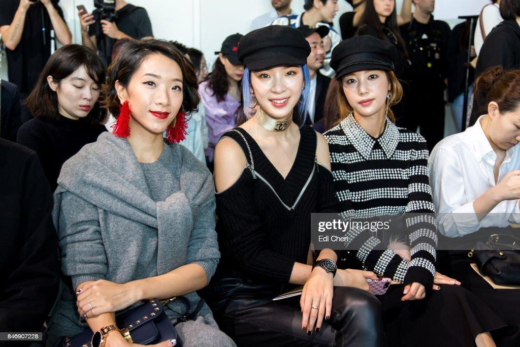 Veronica Li, Irene Kim & Ki Eun-Se attend the Michael Kors runway show during New York Fashion Week at Spring Studios on September 13, 2017 in New York City.