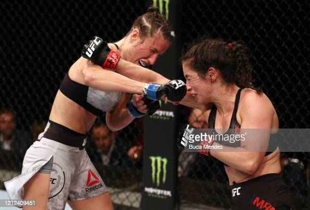 Veronica Macedo of Venezuela and Bea Malecki of Sweden trade punches in their bantamweight fight during the UFC Fight Night event on March 14 2020 in...